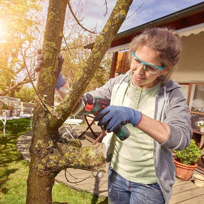 NanoBlade Mini Chainsaw Cutting A Tree Branch