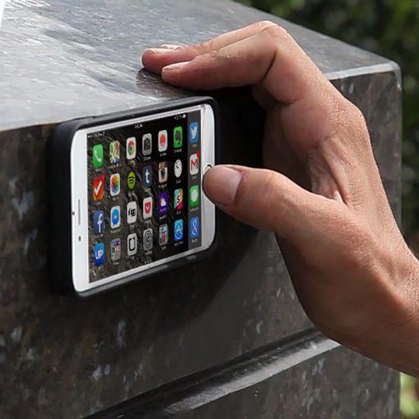 Anti Gravity iPhone Case Stuck On Wall (Mega Tiny Corp)